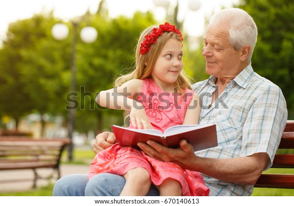 Image result for picture of a little girl sitting on the lap of a grandpa