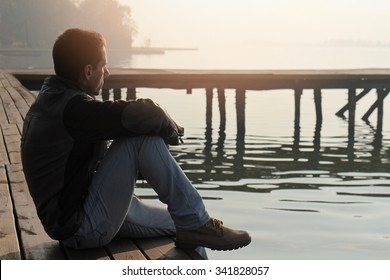 Image result for picture of a person sitting alone thinking mode
