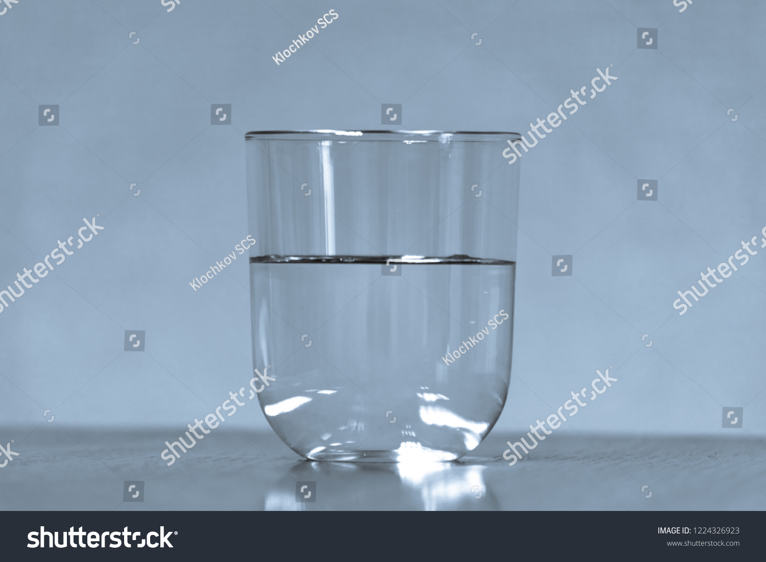 Glass with liquid on a wooden table