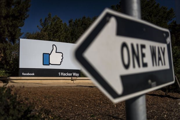 Signs in front of Facebook Inc.'s headquarters in Menlo            Park, California on Tuesday.