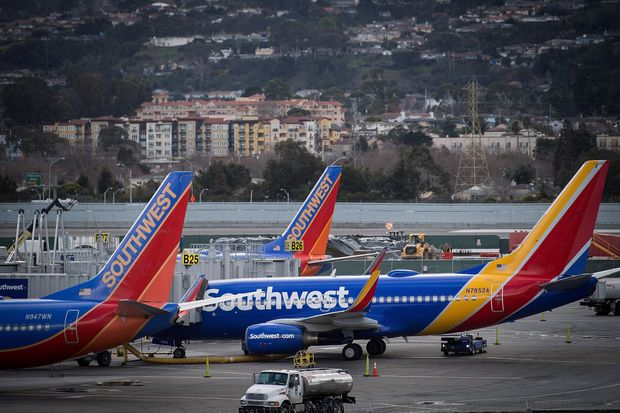 Southwest Airlines Co. planes stand on the tarmac at San Francisco International Airport last week. The carrier said Thursday it expects a strong first quarter.