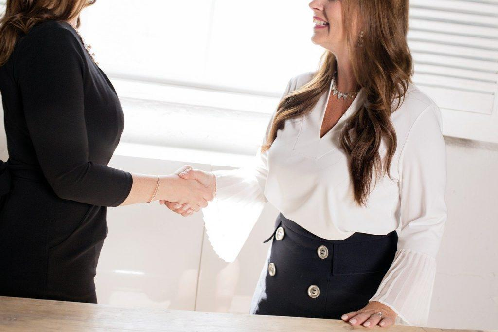 A person shaking hands with a real estate agent.