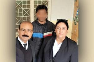 Salamat Mansha Masih (back, face blurred)