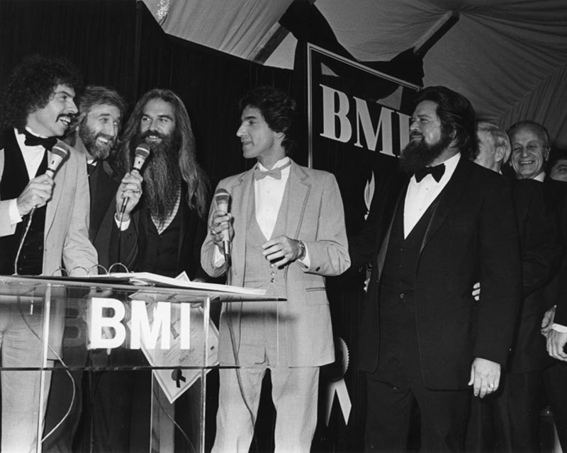 Joe Bonsall, Duane Allen, William Lee Golden, Richard Sterban, Dallas Frazier and Wesley Rose at the 1982 BMI Awards.