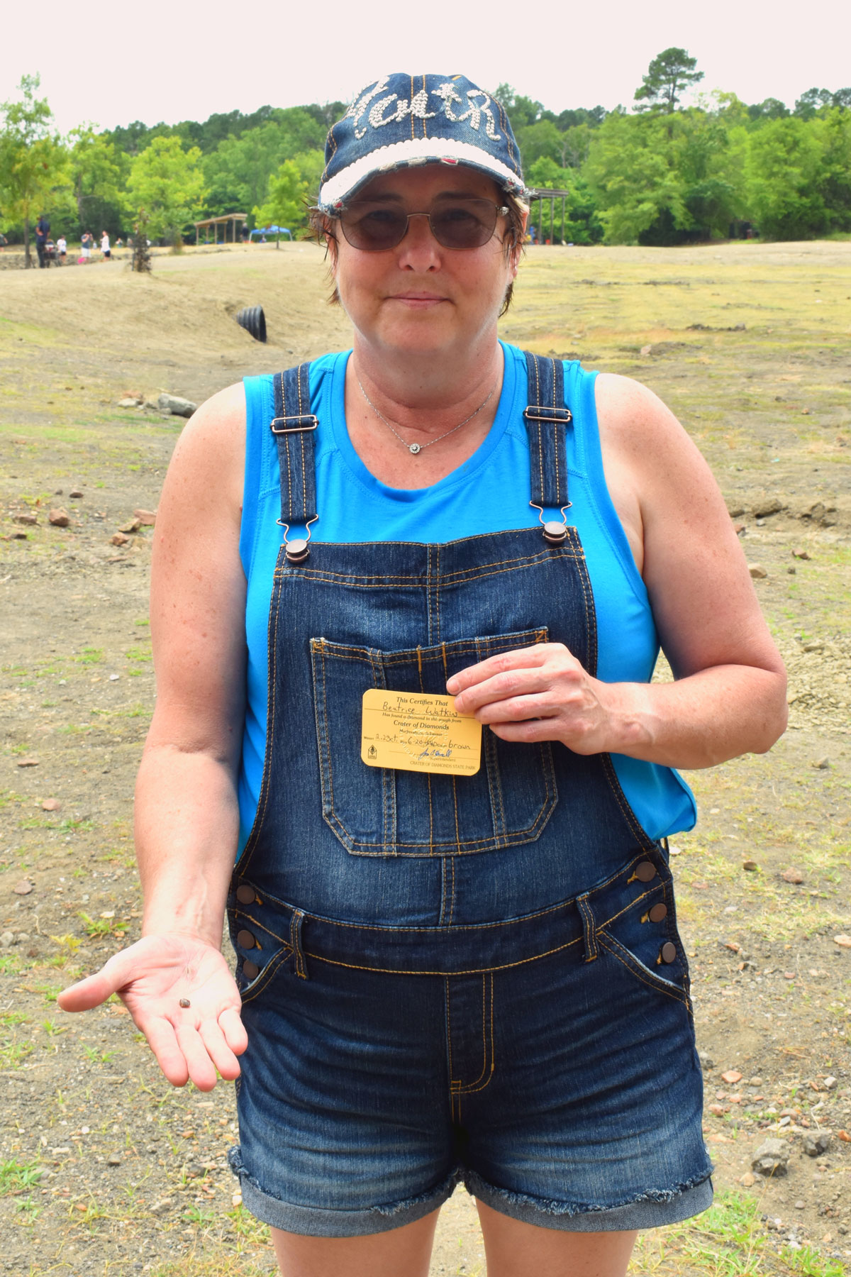 Beatrice Watkins holding her brown diamond she found at Crater of Diamonds State Park