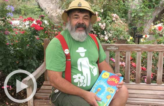 Staff member John Villarreal with The Lorax book