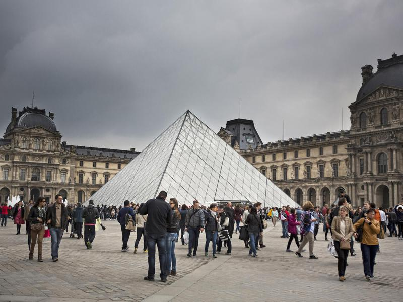 The world-famous entrance to the Louvre is a hot spot for tourists.
