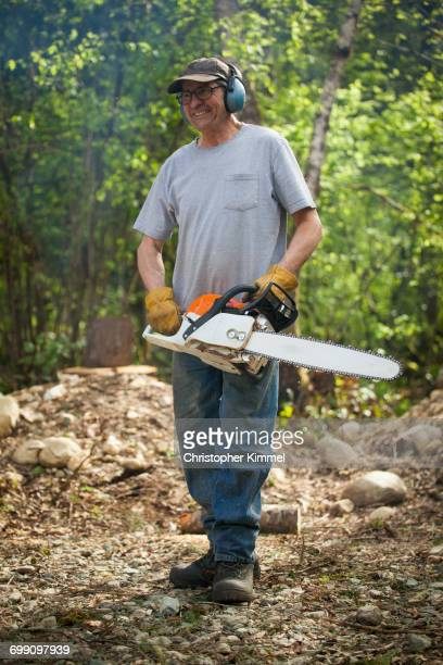 Image result for picture of a man with a chain saw