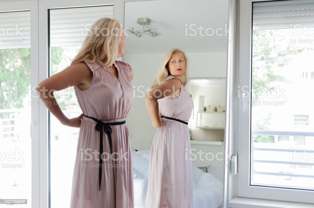 Image result for picture of a woman standing in front of a mirror""
