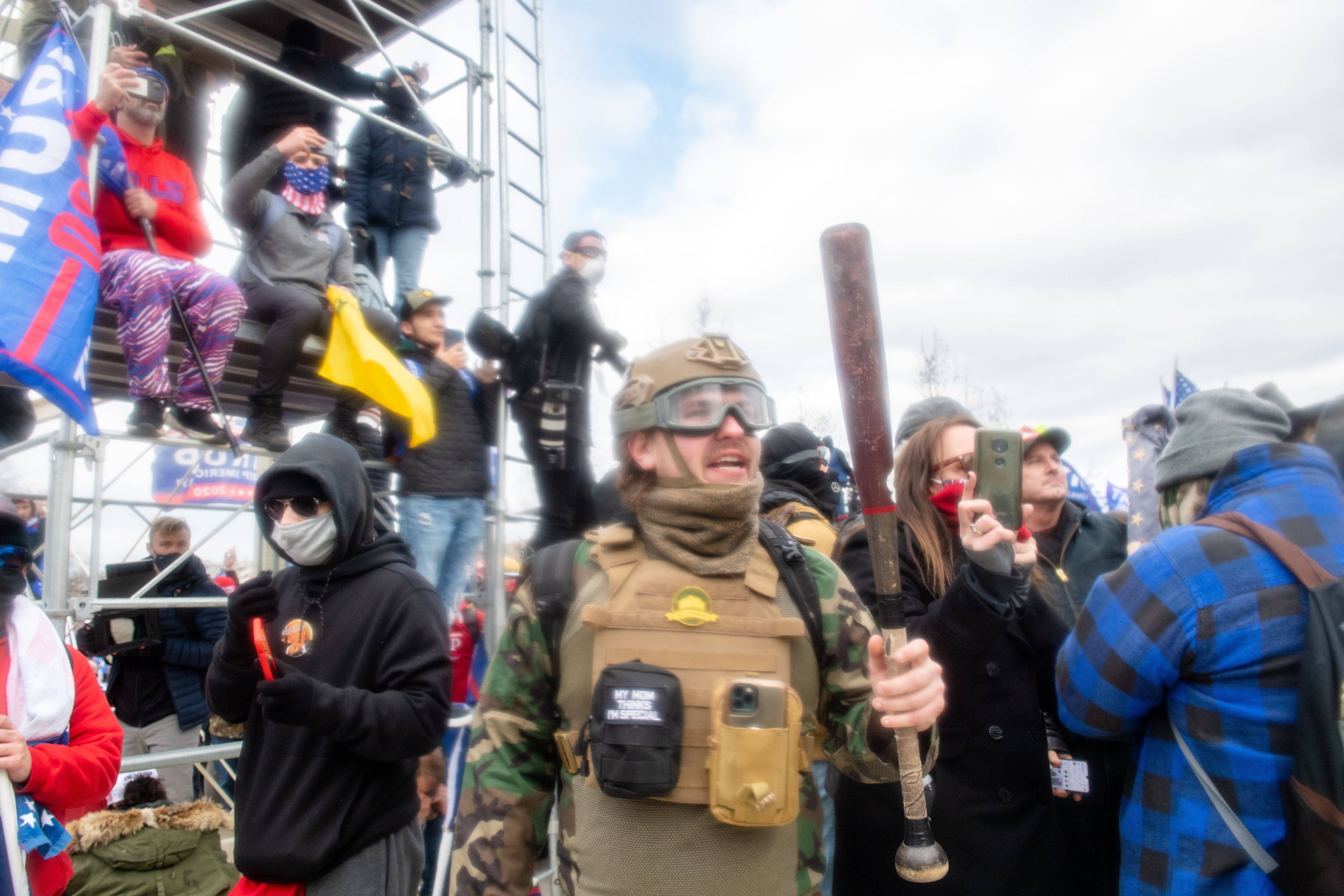 A man wields a baseball bat during the storming of the U.S. Capitol on Jan. 6 by a pro-Trump mob. (Amy Harris/Shutterstock)
