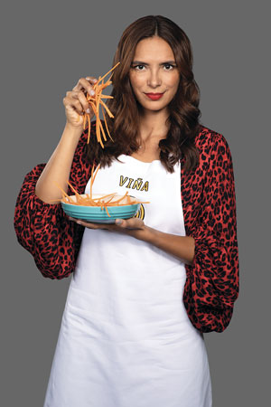 A person holding a bowl of food  Description automatically generated with low confidence