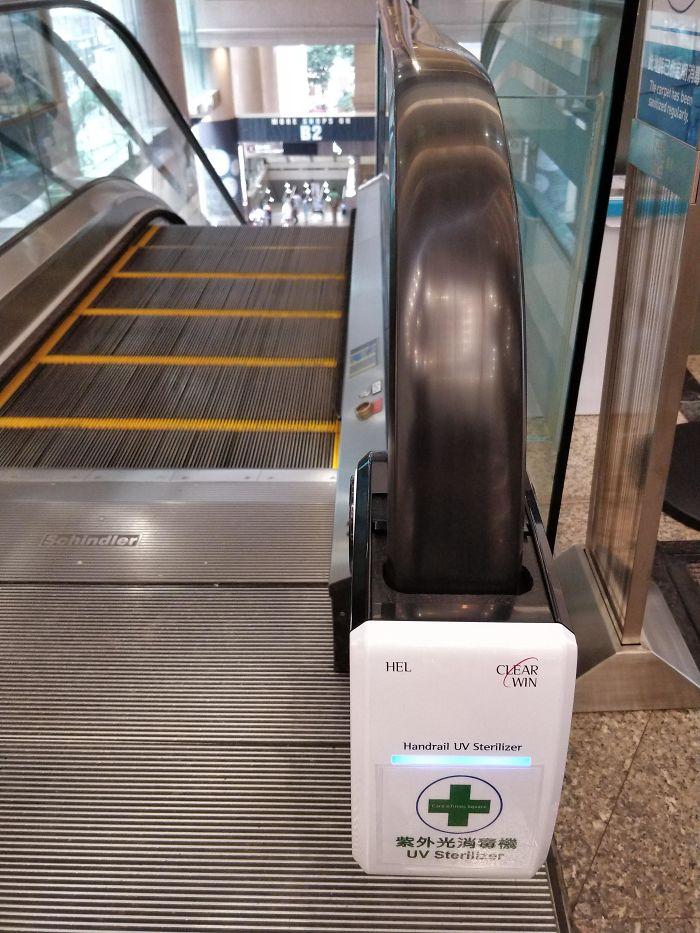 This UV Handrail Sterilizer On An Escalator In Hong Kong