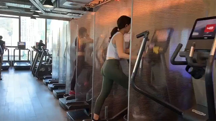 Gym In Hong Kong, Glassseparate The Cardio Machines To Help Prevent Droplets From Spreading