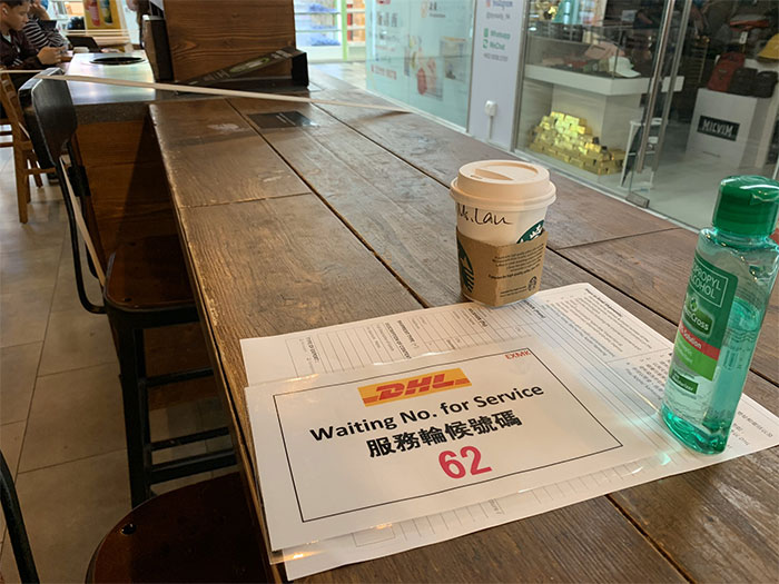 Every Other Seat At Starbucks Taped Off, Hong Kong