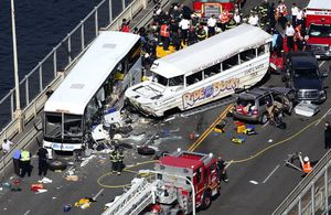 The scene on the Aurora Bridge in Seattle on Sept. 24, 2015, after a Ride the Ducks vehicle collided with a charter bus. (Ken Lambert / The Seattle Times)