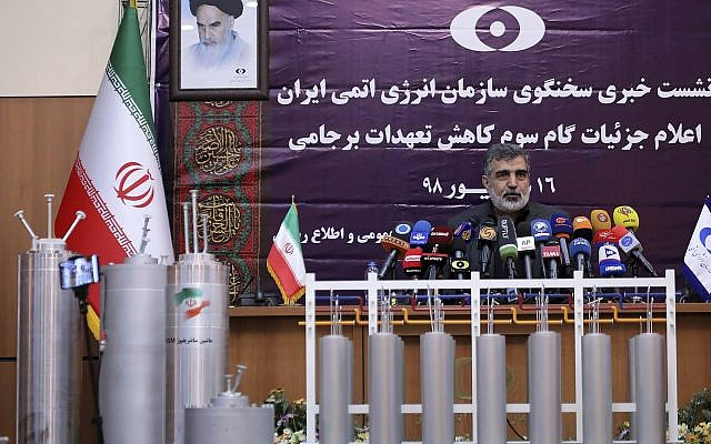In this photo released by the Atomic Energy Organization of Iran, spokesman of the organization Behrouz Kamalvandi speaks in a news briefing as advanced centrifuges are displayed in front of him, in Tehran, Iran, Sept. 7, 2019 (Atomic Energy Organization of Iran via AP)