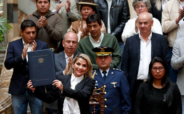Jeanine Añez Chavez after enacting a law to hold new elections in Bolivia.