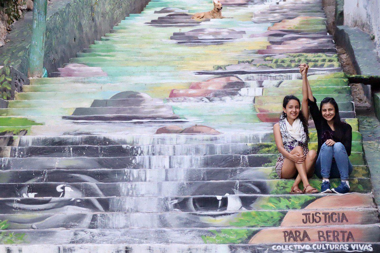 Bertha and Laura Zúniga Cáceres at a mural made by el Colectivo Culturas Vivas, Tegucigalpa, Honduras, 2021.