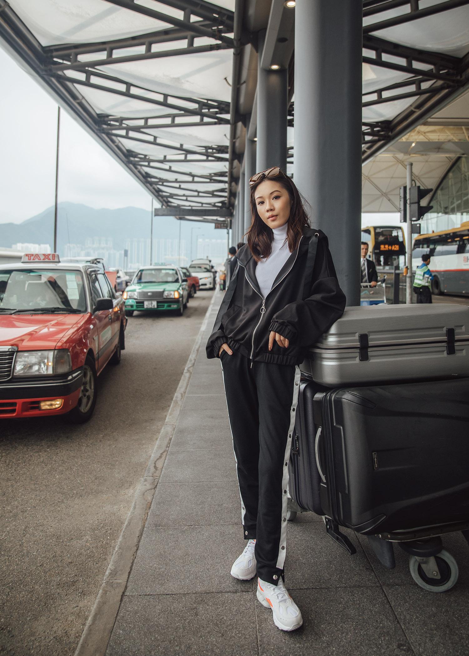 Jenny Tsang of Tsangtastic wearing airport activewear outfit in Hong Kong