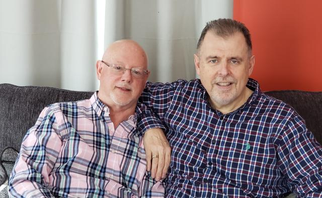 Harry Stewart and Chris Southin, founders of Rainbow Camp, seated on sofa