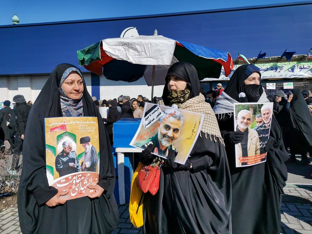 Iranian women carry a portrait of slain Iranian General Qasem Soleimani, on the 40th day of his killing in a US drone strike. (AFP)