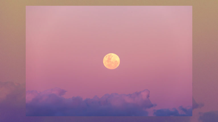 halloween horoscopes 2020: a full moon against a pink sky with purple clouds