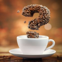 coffee beans rising out of a white cup and saucer in the shape of a 3D question mark