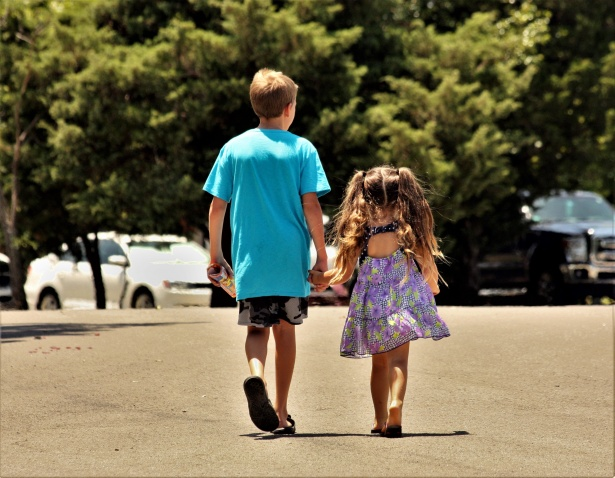 Image result for picture of two children walking along holding hands