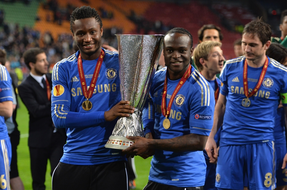 Mikel poses for the camera with team-mate Victor Moses after winning the Europa League