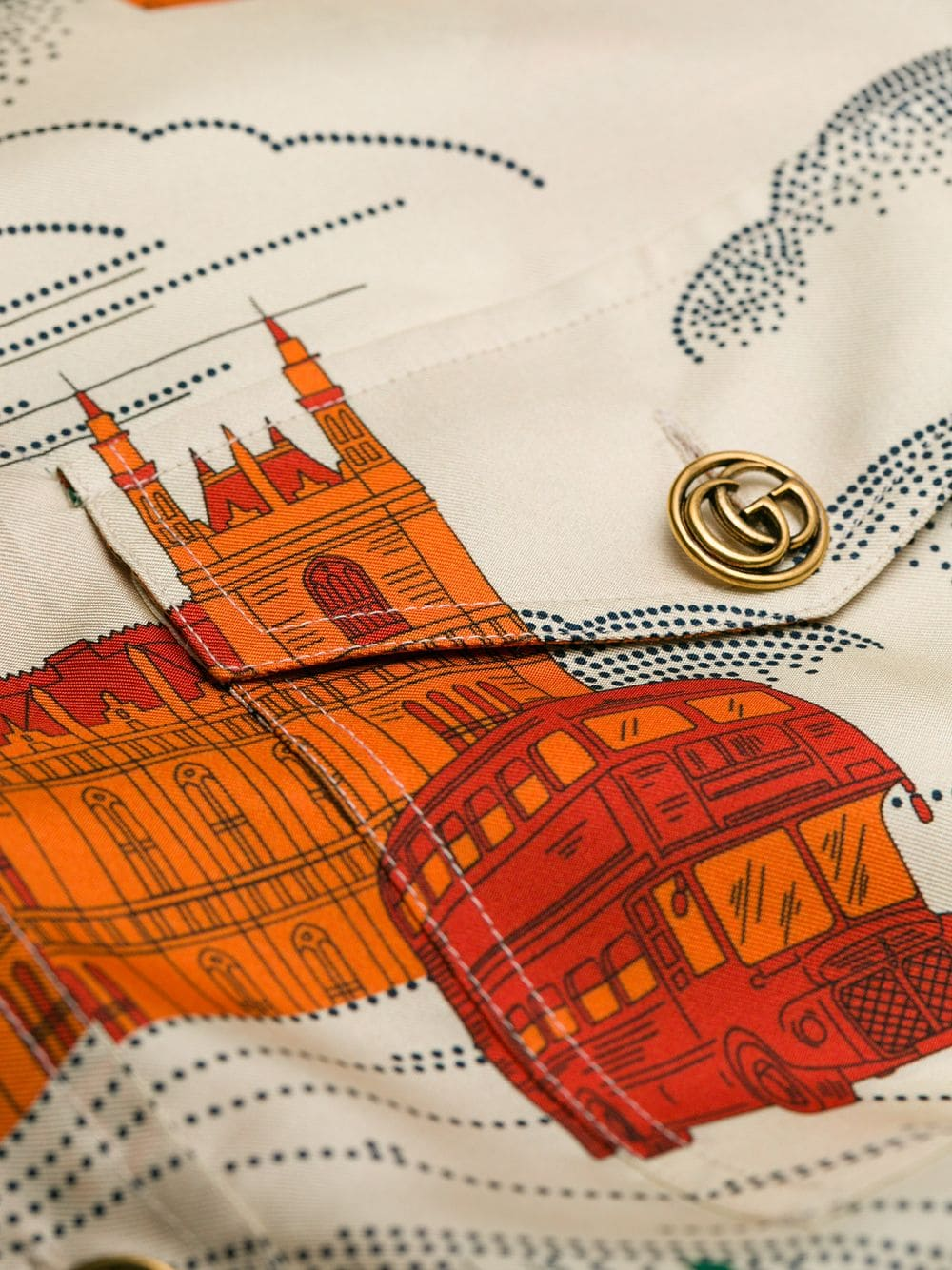 The £3,500 frock is printed with the Houses of Parliament and red double decker buses