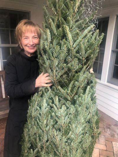 [photo: Kate with Christmas tree]