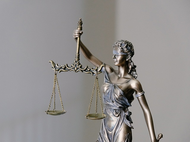 A bronze statue of lady justice